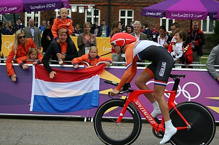 Ellen van Dijk supported by Willem-Alexander of the Netherlands and his family at the 2012 Summer Olympics. Ellen van Dijk, Time Trial Olympic Summer Games 2012.jpg