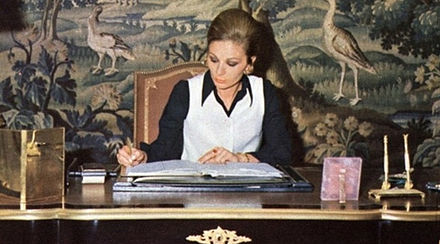 Shahbanu Farah at work in her office in Tehran, 1970s. Empress Farah Office.jpg