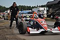 F2000 cars leave secondary pits for practice (5976945160).jpg