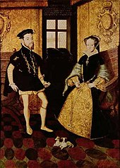 A painting in mostly black, yellow and red of a man and a woman in 16th century clothing sitting. There are two small mostly white dogs at the feet of the couple.