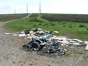 English: Fly tipping Fly tipping below the Com...