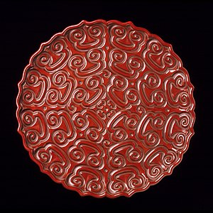 "Carved lacquer - Foliated dish or tray in the tixi technique with the guri or ""Sword-Pommel Pattern"", here using red with three thin layers of black. The polished top layer of red contrasts with the duller bottom layer. Early Ming."