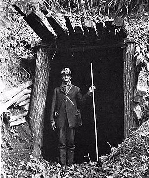 Drift mining - Coal miner standing in a drift portal at Fork Mountain, Tennessee, 1920.