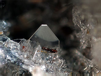 Forsterite - Forsterite (big tabular and colorless) on sanidine (little colorless crystals) with hematite (reddish)