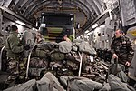 French troops secure gear on C-17 flight to Mali 130121-F-MS171-013.jpg