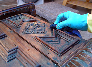 English: Furniture conservation - applying pai...