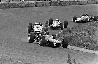 BRM P261 - Graham Hill in his BRM P261, leading in the early laps of the 1965 Dutch Grand Prix. He had started in pole position, but finished the race in fourth.