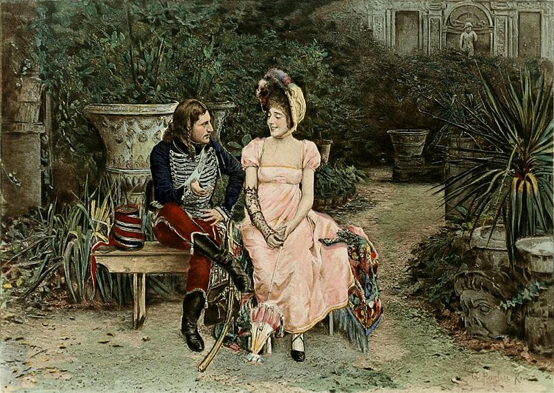 Image shows a woman in a high-waisted pink dress and a bonnet, sitting next to a man in a uniform that has a black jacket with white piping across the chest, maroon trousers, and leather boots. They're sitting on a bench in a garden, looking at each other, obviously courting.