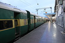 Green-and-yellow passenger train