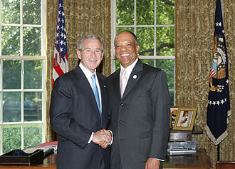 Ewart Brown - Brown with former US President George W. Bush in the Oval Office in 2008.