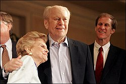 Gerald Ford is embraced by his wife Betty Ford