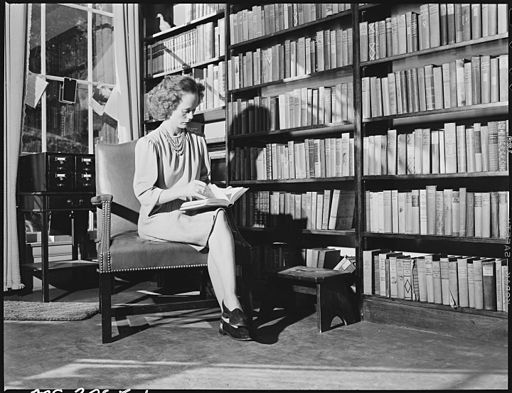 Geraldine Fain, daughter of Harry Fain, coal loader, browses in free library supported by the company. Librarian... - NARA - 541514