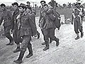 German prisoners being escorted by Indian troops after the Battle of the Sangro 1943.jpg