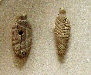 Swaddling - Swaddled babies. Votive offerings from Agia Triada (Crete), Bronze age, 2600-2000 BC., Heraklion (Iraklion), Crete. Archeological museum Iraklion