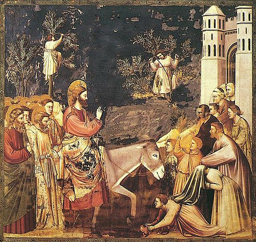 Jesus enters Jerusalem and the crowds welcome him, by Giotto, 14th century. Giotto - Scrovegni - -26- - Entry into Jerusalem2.jpg
