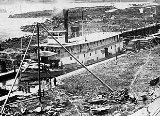Willamette Falls Locks - Sternwheeler Governor Grover in the locks, probably lock 3, in 1873.  The lock walls on the east side of the canal can be seen, as well as the masonry for the lock gates and the protective wooden fenders projecting above the lock walls.
