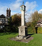 Sundial to the middle of the green at Blaise Hamlet