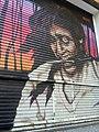Graffiti mujer y cuchillo en Rosario.jpg