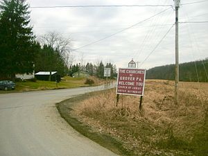 Canton Township, Bradford County, Pennsylvania - Sign for the churches of Grover, Pennsylvania, located within Canton Township, as seen at a turn from State Route 154 in February 2012