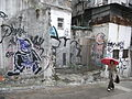 HK Central 吉士笠街 Gutzlaff Street Graffiti back lane wall rainy day visitor.jpg