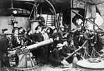 HMS Vindictive crew with weapons after Zeebrugge Raid Apr 1918 IWM Q 55568.jpg