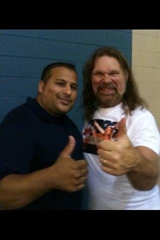 "Jim Duggan - ""Hacksaw"" Duggan (right) poses with a fan at an independent show in 2013"