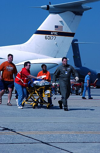 Hanoi Taxi - Volunteers from Dobbins, ARB, Ga, shuttle a patient who arrived there on Hanoi Taxi. About 100 Hurricane Katrina victims were airlifted to Dobbins for transportation to hospitals in Atlanta.