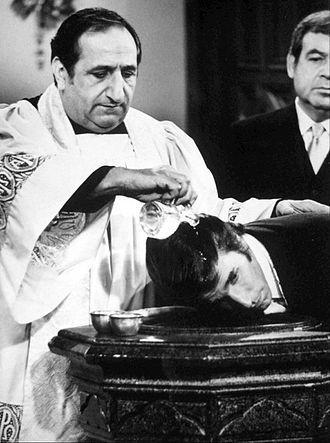 Al Molinaro - Molinaro as Father Anthony Delvecchio the twin brother of Al Delvechhio on Happy Days, performing Fonzie's baptism in 1977