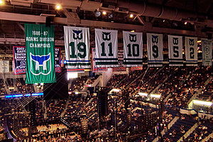 Hartford Whalers - Whaler banners hanging from the Hartford Civic Center rafters in 2007. The numbers 2, 9 and 19 were retired while the team was still in Hartford and honor Rick Ley, Gordie Howe and John McKenzie, respectively. In 2006, the numbers 5, 10 and 11 were added by Hartford Wolf Pack management in honor of Ulf Samuelsson, Ron Francis and Kevin Dineen, respectively. These are joined by a banner commemorating the Whalers' only divisional title and a New England Whalers championship banner.