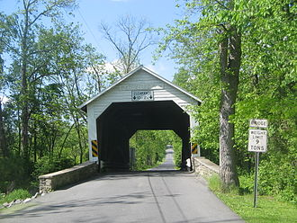 Wing wall - The entrance to Hassenplug Covered Bridge in Mifflinburg, Pennsylvania is flanked by wing walls.