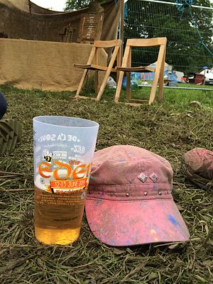 Eden Festival - Hat after a paint fight at Eden Festival in 2014 and a pint of cider in a reusable pint glass.