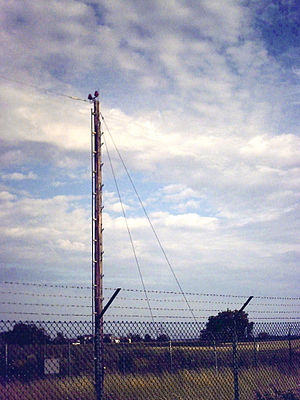 Non-directional beacon - One of the wooden poles of NDB HDL at Plankstadt, Germany