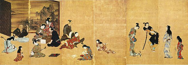 A folding screen paintined with Japanese figures at play against a gold background