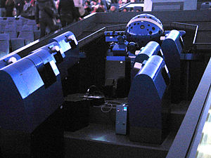 Planetarium projector - A Konica Minolta Infinium projection system at the Osaka Science Museum, with a starball in the back and the auxiliary projectors for planets in the front. These projectors are complemented by a Virtualium II digital projection system.