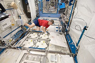 International Space Station - ISS crew member storing samples