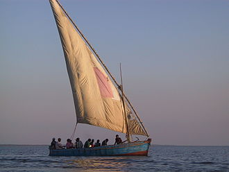 "Lateen - Dhow with lateen sail in ""bad tack"" with the sail pressing against the mast, in Mozambique."