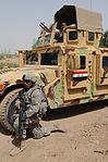 Iraqi soldiers patrol neighborhood east of Baghdad, Iraq DVIDS179797.jpg