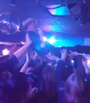 Legendary Shack Shakers - J.D. Wilkes of Legendary Shack Shakers crowd surfs while performing in Atlanta, Georgia in 2016.