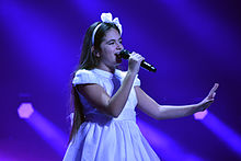 Photograph of Gaia Cauchi performing in a rehearsal at the 2013 Junior Eurovision Song Contest