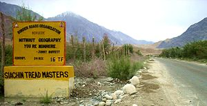 Jimmy Buffett - Jimmy Buffett quotation on Himank/BRO signboard in the Nubra Valley, Ladakh, Northern India