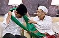 Joko Widodo was given a turban by Maimun Zubair.jpg