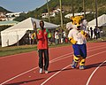 Kim Collins, World Championship Sprinter and Shera, the mascot for the Commonwealth Games 2010 Delhi at the Interschool Championship at the Silver Jubilee Athletic Stadium in St Kitts on March 21, 2010.jpg