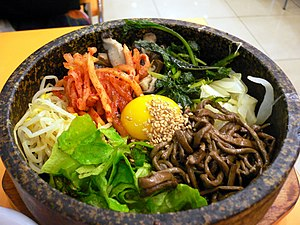 Dolsot bibimbap, a Korean traditional dish com...