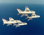 LTV A-7E Corsair IIs of VA-147 in flight over the Indian Ocean on 14 November 1974 (NNAM.1996.253.7103.014).jpg