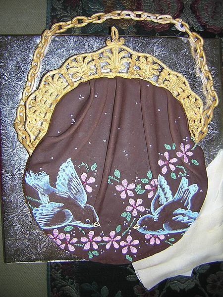 lady's evening bag cake with frosting