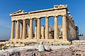 Lady sitting in front of Parthenon on Acropolis, Athens, Greece (17088729869).jpg