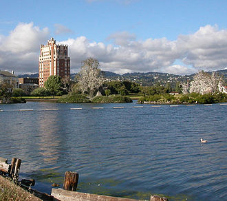 Lake Merritt - A view looking east toward man-made islands of the Lake Merritt Bird Sanctuary. The Bellevue-Staten apartment building is in view, and the Oakland/Piedmont Hills are in the background.