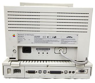 """Macintosh LC II - Rear view of a Macintosh LC II, paired with a 12"""" RGB display."""