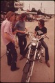 MOTORCYCLIST FROM LEAKEY, TEXAS, STOPS TO TALK WITH FRIENDS NEAR SAN ANTONIO - NARA - 554875.tif