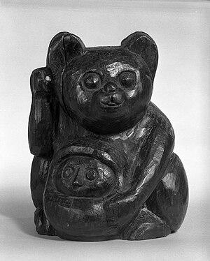 Maneki-neko - A wooden mold for a Maneki-Neko and Okiagari-Koboshi Daruma figure from the Edo Period, 18th century. Brooklyn Museum.